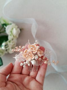 This beautiful handmade bridal hair comb made with pretty crystal elements, handcrafted flowers and peach glass pearls. Complement most wedding hairstyles. It is the perfect bridal headpiece for that woman who wants to simply sparkle on her wedding day. Perfect for a simple hairstyle and also ideal as bridesmaids gifts.  DIMENSIONS: 4 x 2 (10 x 5 cm) (Please note, this does not include the comb itself).  Silver, gold or rose gold tone finish.  View my shop for more handmade bridal…
