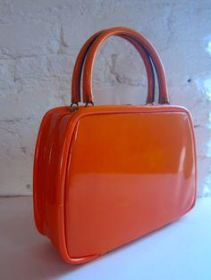 SOLD!! Hard shell vintage orange handbag. 60's.  https://www.etsy.com/listing/116443193/hard-shell-vintage-orange-handbag-60s