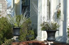 Do you prefer holiday decorations that look relatively natural, such as the urn displays in this picture? Then you'll probably enjoy browsing these ideas: http://landscaping.about.com/od/winterlandscaping/a/xmas_decoration.htm