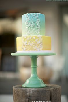 Yellow, Blue, and Green Wedding Cake with Lace Detail