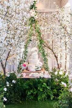 Over the top wedding cake display by Nisie's Enchanted Florist
