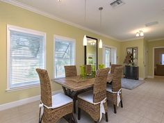 Naples Hot Properties - Coastal Dining - rattan seagrass chairs.  Olde Naples