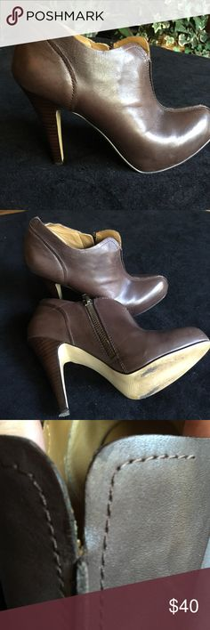 "Oh so sexy Brown Nine West booties These are so adorable! 4"" inch heel with 1/2 concealed platform. Curved split at the top (picture 3) so you can show a little foot cleavage. Perfect for Fall! Slight wear on the soles but otherwise perfect. Leather upper Nine West Shoes Ankle Boots & Booties"