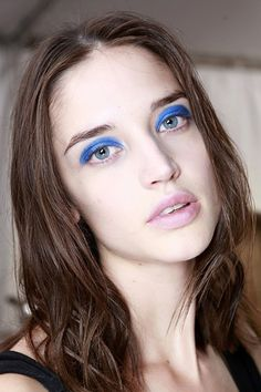 Marc by Marc Jacobs,  the trick for making the blue eyeshadow look modern: Keep other makeup to a minimum to let the eyes really stand out