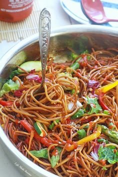Rainbow Asian Skillet Peanut Noodles - Super easy & delicious peanut noodle stir-fry is made with gluten free pasta noodles, colorful veggies and a sweet and savory peanut sauce that comes together in under 30 minutes.  Perfect for weeknights.weeknight meal Ready in under 30 minutes.jpg