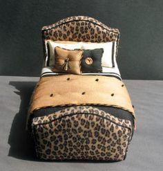 Unusual Leopard padded headboard and foot board bed dressed in silks. $190.00