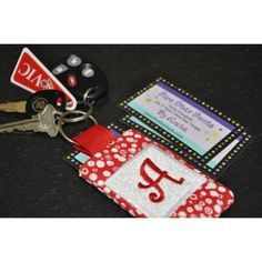4x4 Quilted Monogram Pocket Keychain he pocket on the back is sized perfectly for a driver's license, credit card, business card and even gift cards.