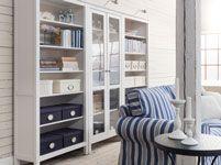 """2x Hemnes Bookcases, 1x Hemnes Glass-Door Cabinet, 3x Cabinet Lighting + molding to hide seams and legs = """"built in"""" cabinet"""