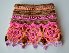 Colorful and sophisticated hand crocheted cuff bracelet in fuchsia, orange and brown colors. The bracelet is embroidered with tiny glass beads. Two