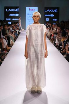 Surreal white drapery in a collection inspired by a state of meditation at #lakmefashionweek by INIFD Corporate presents #GenNext designer p.e.l.l.a #SummerResort2015