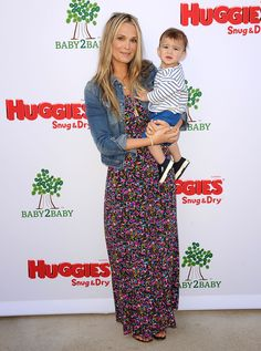 : Molly Sims tempered her busy floral maxi dress with a denim jacket at a Baby2Baby event in LA.