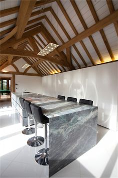Minotti Cucine Gandhara Kitchen with stone drawers in Luis Blue granite, and wall-system doors