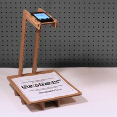 ScanDeck™ is an affordable, recyclable and easy-to-use copy stand designed to hold your iPhone at just the right height, and keep it there.