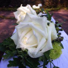 Gorgeous crisp white rose buttonholes.