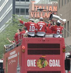 Chicago Blackhawks Patrick Sharp, Brent Seabrook and Duncan Keith travel down Monroe St. in their victory parade through downtown Chicago Thursday.