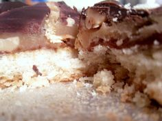 baby ruth cookie bars -- homemade baby ruth spread over a sugar cookie