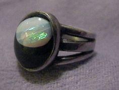 Armand Winfield, USA: ring  sterling silver, opal, black velvet encased in acrylics    1946