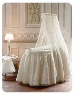 Long oval Antique Lace Bassinet with veil.