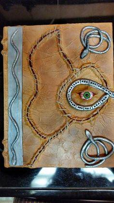 """Making a """"Hocus Pocus"""" style spell book using tissue paper, clay, twine, paint, mod podge, a little glue, & a 26mm half round eye....  (I get the eyes…"""