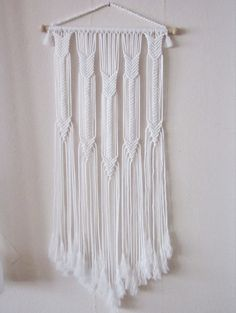 "Macrame wall hanging - Arrows - unique and stylish wall decor for your home or office. Handmade, original idea and design by Evgenia Garcia. Color: white Sizes: Dowel width – 19 1/4 (49 cm) Panel height from dowel to longest end – 41.5"" (105.5 cm) Cord diameter - 4 mm NOTE: 1. The colors on your display may differ slightly from actual colors. 2. Clean the dust with a soft brush gently. If you have any questions about this item - please contact me. I am ready to help you at any time. It..."
