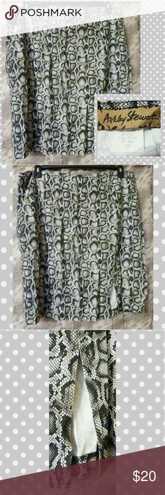 """Black/White/Gray Snake Print Pencil Skirt Sz 18 PREOWNED Ashley Stewart brand Black/White/Gray Snake Print Pencil Skirt Sz 18.  -All over black, white, & gray colors -All over Snake print -6"""" long bottom left side slit -8"""" long back zipper -Has no stretch -Super Lightweight -Very soft woven material -Made of 55% Rayon/45% Acetate  MEASUREMENTS: Waist: 19"""" Hips: 26"""" Total Length: 23"""" Ashley Stewart Skirts Pencil"""