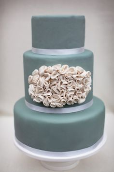 ruffled wedding cake - could do 3 bright fondant colours with white ruffles in heat shape on 1 or 2 layers