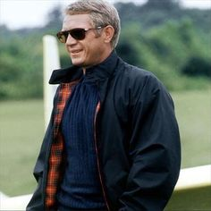 The Thomas Crown Affair is just one of many films that put the Harrington jacket on the menswear map, worn by Steve McQueen here with navy knitwear and his signature Persol sunglasses in Find. Steven Mcqueen, Gq, Harrington Jacket, Mode Masculine, Men's Style Icons, Steve Mcqueen Style, Steve Mcqueen Jacket, Thomas Crown Affair, Der Gentleman