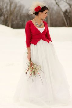 Red cardigan and snow.