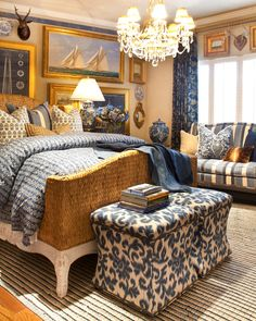 Interiors | Gary Riggs Home- note the rattan footboard, artwork, antlers.. blue upon blues..