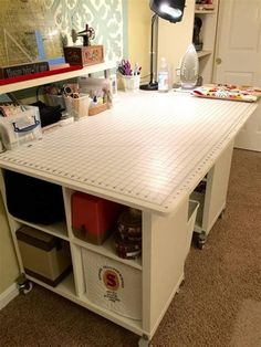 Cutting table using IKEA Kallax cube shelves & existing top from Jo-Ann's craft table. Ikea Sewing Rooms, Sewing Room Furniture, Office Furniture Design, Furniture Decor, Sewing Room Design, Craft Room Design, Sewing Room Organization, Craft Room Storage, Organizing