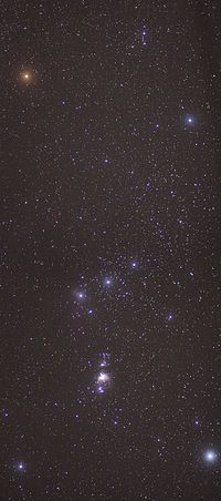 The constellation of Orion with the Orion Nebula (lower middle).