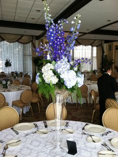 Trumpet centerpieces with submerged orchids topped with - Blue and white centerpieces ...