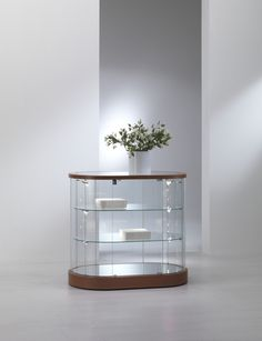 Elegance Oval Display Counter has lockable doors and is available in light grey or cherry.