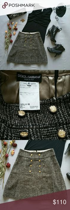 "DOLCE & GABBANA WOOL & SILK SKIRT *SALE IS FOR SKIRT ONLY!  *IN EXCELLENT PRE-OWNED CONDITION. EYE OF CLASP AT BACK ZIP CLOSURE MISSING *I WILL ONLY PART WITH THIS SKIRT FOR A REASONABLE PRICE. OTHERWISE I WILL HAPPILY KEEP IT IN MY PERSONAL CLOSET!  *100% VIRGIN WOOL; LINED IN 100% SILK  *SUPER VERSATILE & CAN BE ENDLESSLY STYLED THROUGH FALL & WINTER *SIZE 40 IS APPROX = TO US SIZE 6. PLEASE SEE MEASUREMENTS FOR BEST FIT  *ALL FRONT BUTTONS HAVE D&G EMBLEM  *WAIST 28"" *LENGTH 21.5"" *SMOKE…"