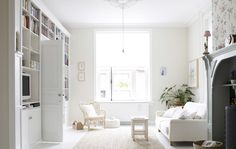 Yvonne's large, white living room has a blend of modern Scandinavian and traditional country style