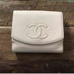 Authentic Chanel Embossed CC Logo Wallet In good condition Authentic bi-food snap Chanel wallet. Color is cream.  Has some discoloration inside the wallet as shown in picture. There is a pen mark on the flap. It has been used but still in good condition. Other than that it's still a great wallet. Comes with authentication card. Sorry no box or dust bag.❌Mo trades or modeling. Always open to reasonable offers. Thank you‼️ CHANEL Bags Wallets