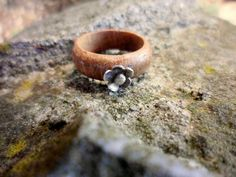 Wood ring with silver flower
