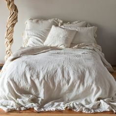 "Whisper Linen is gossamer, loosely woven 100% linen that epitomizes Bella Notte's casual elegance. The Whisper duvet cover pairs signature solid linen for the top and bottom of the cover, trimmed out on three sides with an ethereal 5"" Whisper Linen ruffle."