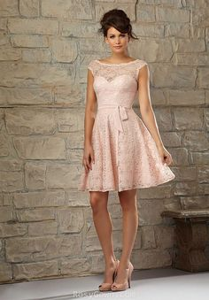 This cap-sleeve bridesmaid dress features sheer scooped neckline with sweetheart bodice. The V back is covered with illusion cutout lace and is closed with cotton buttons which adds a romantic and elegant feeling. Cinched at the waist with a simple band, this A-line dress runs to the above knee length with elegant lace overlays.