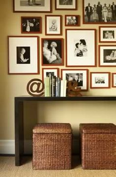 photo collage wall black and white photos with brown wooden frames love this look