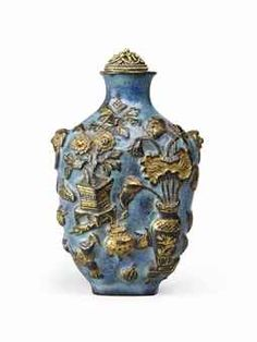 A GILT-DECORATED MOULDED PORCELAIN SNUFF BOTTLE 19TH CENTURY
