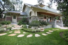 Craftsman, raised panel tapered columns, field stone columns, exposed rafter tails, bead board ceiling.