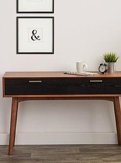 Cet article est disponible pour achat en ligne et livraison à domicile uniquement.     Avec son esthétique des années 50, cette table console aux lignes épurées et aux tons de noyer chaleureux est dotée de tiroirs sur rails noirs contrastants et de poignées en acier inoxydable.      MATÉRIAUX ET FINI   Bois verni et acier inoxydable  Assemblage requis      ENTRETIEN   Utiliser des produits standards servant à nettoyer et préserver le bois.      DIMENSIONS   Hauteur : 30 pouces  Largeur…