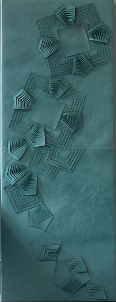 GENEVIEVE BENNETT A decorative leather wall panel made from hand cut and sculpted leather with a geometric motif inspired by Art Deco textiles and glassware. Art Du Cuir, Wall Design, Design Art, Leather Wall Panels, Motif Art Deco, Art Deco Wallpaper, Shades Of Teal, Aqua, Turquoise