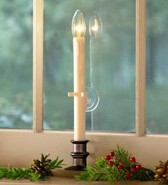 LED Suction Cup Window Candle with Auto Timer | Cordless Window Candles - Candle features an outward-facing LED for a brighter shine outside and a more subtle display indoors. This convenient candle has a suction cup backing that attaches to your window for perfect placement.
