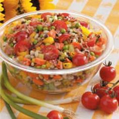 Black-Eyed Pea Salad with peas, corn, tomatoes, scallions and a flavorful dressing....