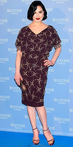 Last Night's Look: Love It or Leave It? | DITA VON TEESE | in an embellished eggplant Jenny Packham dress, metallic clutch and sandals at a Belvedere Vodka event in Madrid.