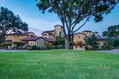 Inspired by a Tuscan farmhouse village concept and designed by noted architect Charles Travis, the home is