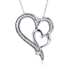 This diamond double heart pendant features a captivating double-heart design with 40 pavé-set diamonds in 14K sterling white gold. The entire creation is expertly finished and it comes with an excelle