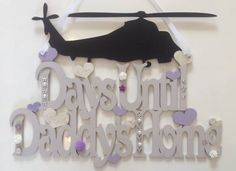 """Days Until Daddy's Home"" plaque with blackboard chopper for your wee one to countdown the days. This one was painted a soft grey, lilac and ivory with glitter, pearls and rhinestones added to make it super girly. £15. x"